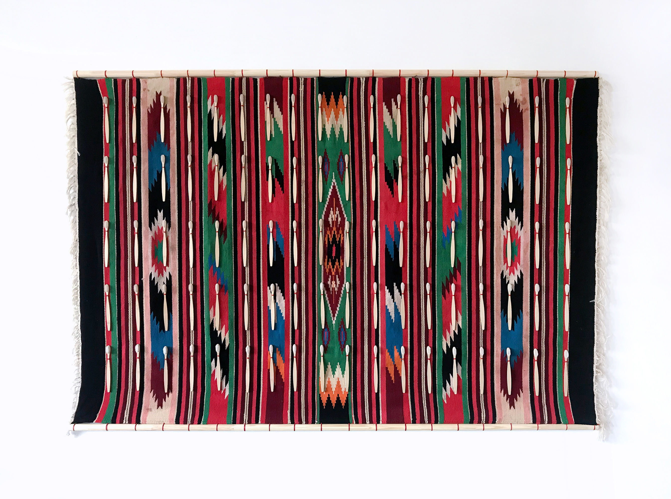Day by weight of gold. Installation made from authentic west-Ukrainian carpet and toothbrushes.